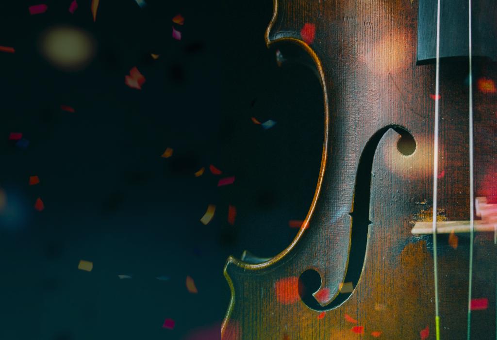A cello covered in confetti.